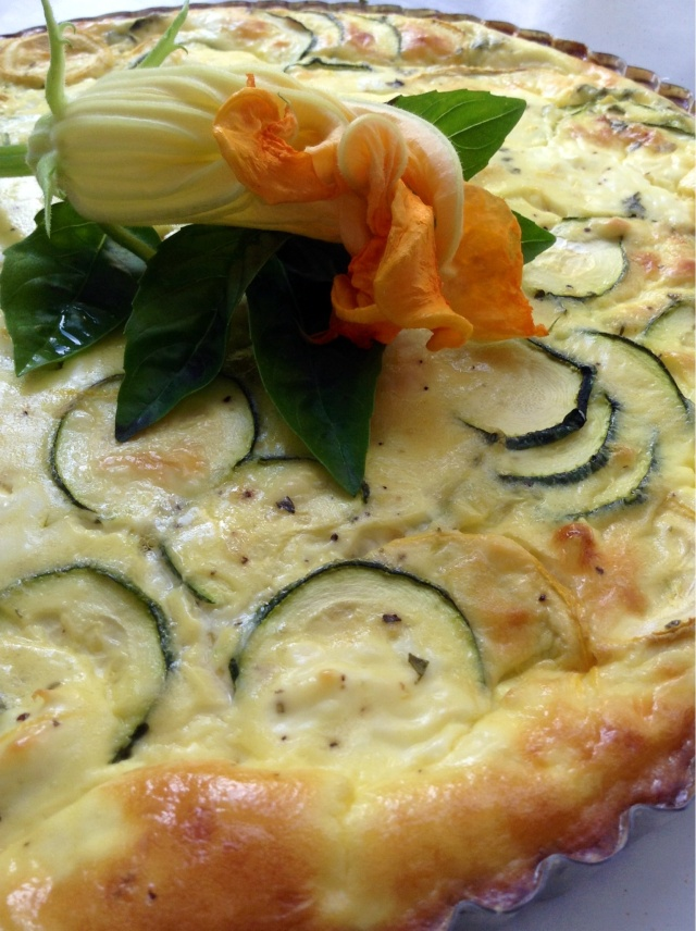 This is a delightfully light and savory tart. Filled with garden squash, creamy French goat cheese and artichokes. Perfect for a late summer picnic! ~Amy